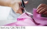 Купить «woman with tailor scissors cutting out fabric», видеоролик № 24781516, снято 3 октября 2016 г. (c) Syda Productions / Фотобанк Лори