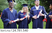 Купить «happy students in mortar boards with diplomas», видеоролик № 24781540, снято 6 октября 2016 г. (c) Syda Productions / Фотобанк Лори