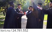 Купить «happy students in mortar boards with diplomas», видеоролик № 24781552, снято 6 октября 2016 г. (c) Syda Productions / Фотобанк Лори