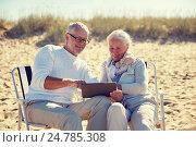 Купить «happy senior couple with tablet pc on summer beach», фото № 24785308, снято 18 августа 2015 г. (c) Syda Productions / Фотобанк Лори