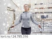Купить «woman exercising with jump-rope outdoors», фото № 24785316, снято 17 октября 2015 г. (c) Syda Productions / Фотобанк Лори