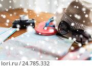 Купить «close up of travel map, flip-flops, hat and camera», фото № 24785332, снято 8 февраля 2016 г. (c) Syda Productions / Фотобанк Лори