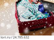 Купить «close up of travel bag with beach clothes», фото № 24785632, снято 9 февраля 2016 г. (c) Syda Productions / Фотобанк Лори