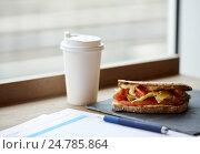 Купить «salmon panini sandwich and cup of drink at cafe», фото № 24785864, снято 22 сентября 2016 г. (c) Syda Productions / Фотобанк Лори