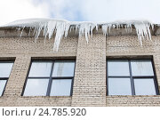 Купить «icicles on building or living house facade», фото № 24785920, снято 11 ноября 2016 г. (c) Syda Productions / Фотобанк Лори