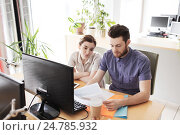 Купить «creative team with computer and papers in office», фото № 24785932, снято 29 марта 2015 г. (c) Syda Productions / Фотобанк Лори