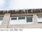 Купить «icicles on building or living house facade», фото № 24786152, снято 11 ноября 2016 г. (c) Syda Productions / Фотобанк Лори