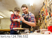 Купить «father and son with drill working at workshop», фото № 24786532, снято 14 мая 2016 г. (c) Syda Productions / Фотобанк Лори