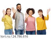 Купить «international group of happy people waving hands», фото № 24786616, снято 29 октября 2016 г. (c) Syda Productions / Фотобанк Лори