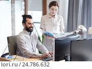 Купить «business team with computer and files in office», фото № 24786632, снято 29 марта 2015 г. (c) Syda Productions / Фотобанк Лори