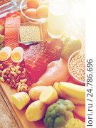 Купить «close up of different food items on table», фото № 24786696, снято 14 мая 2015 г. (c) Syda Productions / Фотобанк Лори