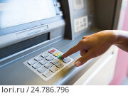 Купить «close up of hand entering pin code at atm machine», фото № 24786796, снято 8 сентября 2016 г. (c) Syda Productions / Фотобанк Лори