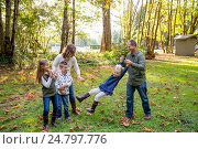 Купить «Lifestyle portrait of five people in a family along the banks of the McKenzie River in Oregon.», фото № 24797776, снято 9 октября 2016 г. (c) easy Fotostock / Фотобанк Лори