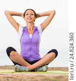 Купить «Glad woman practise yoga cross-legged», фото № 24824360, снято 22 октября 2018 г. (c) Яков Филимонов / Фотобанк Лори