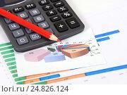 Купить «Графики, диаграммы и калькулятор. Бизнес-натюрморт», эксклюзивное фото № 24826124, снято 5 января 2017 г. (c) Юрий Морозов / Фотобанк Лори