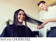 Купить «happy woman with stylist cutting hair at salon», фото № 24830932, снято 15 февраля 2015 г. (c) Syda Productions / Фотобанк Лори