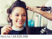 Купить «happy woman with stylist making hairdo at salon», фото № 24830940, снято 15 февраля 2015 г. (c) Syda Productions / Фотобанк Лори