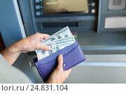 Купить «close up of hand withdrawing money at atm machine», фото № 24831104, снято 8 сентября 2016 г. (c) Syda Productions / Фотобанк Лори