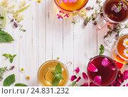 Купить «herbal tea on a white wooden background», фото № 24831232, снято 5 июля 2016 г. (c) Майя Крученкова / Фотобанк Лори