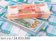 Купить «Heap of five thousandths banknotes of russian roubles and one hundred american dollar bills», фото № 24833880, снято 16 августа 2018 г. (c) FotograFF / Фотобанк Лори