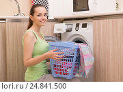 Купить «Woman doing laundry at home», фото № 24841500, снято 27 сентября 2016 г. (c) Elnur / Фотобанк Лори