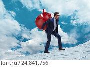 Купить «Businessman carrying the piggybank with savings», фото № 24841756, снято 16 октября 2019 г. (c) Elnur / Фотобанк Лори