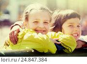 Купить «Little girls cuddling and smiling», фото № 24847384, снято 28 марта 2020 г. (c) Яков Филимонов / Фотобанк Лори