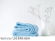 Купить «Minimal elegant composition with blue scarf and white vase», фото № 24849664, снято 29 декабря 2016 г. (c) Екатерина Рыбина / Фотобанк Лори