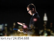 close up of businessman with transparent tablet pc, фото № 24854688, снято 6 сентября 2016 г. (c) Syda Productions / Фотобанк Лори