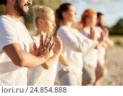 group of people making yoga or meditating on beach, фото № 24854888, снято 7 августа 2016 г. (c) Syda Productions / Фотобанк Лори