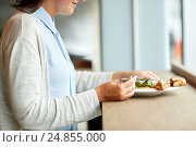 Купить «woman eating gazpacho soup at restaurant», фото № 24855000, снято 22 сентября 2016 г. (c) Syda Productions / Фотобанк Лори