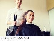 Купить «happy woman with stylist making hairdo at salon», фото № 24855104, снято 15 февраля 2015 г. (c) Syda Productions / Фотобанк Лори