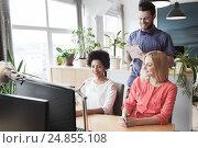 Купить «happy creative team with computer in office», фото № 24855108, снято 29 марта 2015 г. (c) Syda Productions / Фотобанк Лори