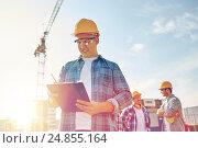 Купить «builder in hardhat with clipboard at construction», фото № 24855164, снято 21 сентября 2014 г. (c) Syda Productions / Фотобанк Лори