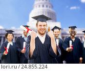 Купить «happy student with diploma celebrating graduation», фото № 24855224, снято 24 сентября 2016 г. (c) Syda Productions / Фотобанк Лори