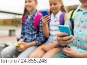 Купить «elementary school students with smartphones», фото № 24855248, снято 24 июля 2016 г. (c) Syda Productions / Фотобанк Лори