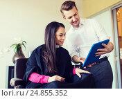 Купить «happy woman and stylist with tablet pc at salon», фото № 24855352, снято 15 февраля 2015 г. (c) Syda Productions / Фотобанк Лори