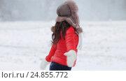 Купить «happy woman having fun outdoors in winter», видеоролик № 24855772, снято 12 января 2017 г. (c) Syda Productions / Фотобанк Лори