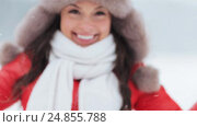 Купить «happy woman playing with snow outdoors in winter», видеоролик № 24855788, снято 12 января 2017 г. (c) Syda Productions / Фотобанк Лори