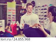 Купить «Couple choosing new sportswear in sports store», фото № 24855968, снято 22 ноября 2016 г. (c) Яков Филимонов / Фотобанк Лори