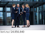 Купить «Businesspeople discussing in office premises», фото № 24856840, снято 6 июля 2016 г. (c) Wavebreak Media / Фотобанк Лори