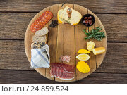 Купить «Gouda cheese, sweet lime, meat, bread slices, black pepper and rosemary on wooden board», фото № 24859524, снято 16 сентября 2016 г. (c) Wavebreak Media / Фотобанк Лори