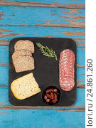 Купить «Brown bread, dutch gouda cheese, rosemary and ham on slate board», фото № 24861260, снято 16 сентября 2016 г. (c) Wavebreak Media / Фотобанк Лори
