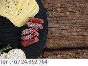Купить «Slices of cheese, rosemary and nacho chips on plate», фото № 24862764, снято 16 сентября 2016 г. (c) Wavebreak Media / Фотобанк Лори