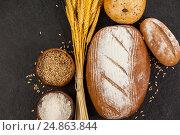 Купить «Bread loaves with wheat grains and flour», фото № 24863844, снято 20 сентября 2016 г. (c) Wavebreak Media / Фотобанк Лори