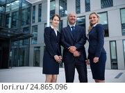 Купить «Confident businesspeople standing in the office premises», фото № 24865096, снято 6 июля 2016 г. (c) Wavebreak Media / Фотобанк Лори