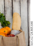 Купить «Fruits and vegetables with bread loaf in grocery bag», фото № 24865640, снято 15 сентября 2016 г. (c) Wavebreak Media / Фотобанк Лори