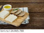Купить «Gouda cheese, brown bread slices and lime juice with knife on chopping board», фото № 24865788, снято 16 сентября 2016 г. (c) Wavebreak Media / Фотобанк Лори