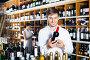 Man choosing bottle of wine, фото № 24866132, снято 15 января 2017 г. (c) Яков Филимонов / Фотобанк Лори