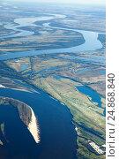 Купить «Oil pumps on the bank of great river, top view», фото № 24868840, снято 11 октября 2015 г. (c) Владимир Мельников / Фотобанк Лори